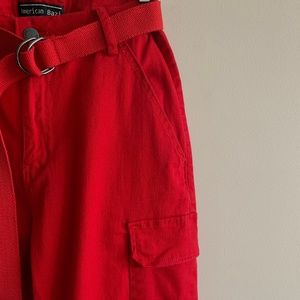 Red cargo pants with belt